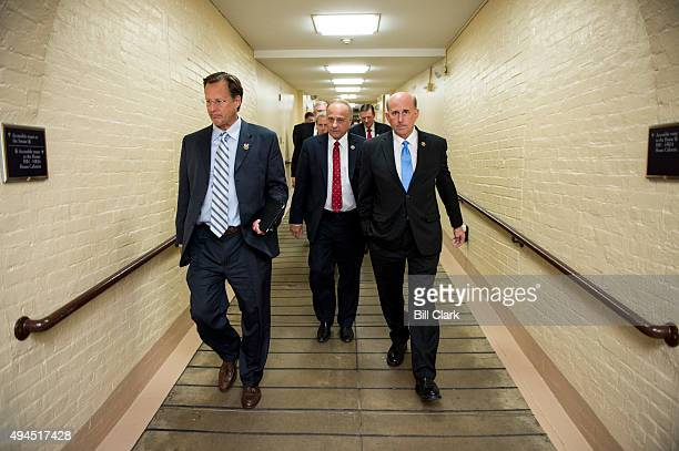 From left Rep Dave Brat RVa Rep Steve King RIowa and Rep Louie Gohmert RTexas arrive for the House Republican Conference meeting in the basement of...