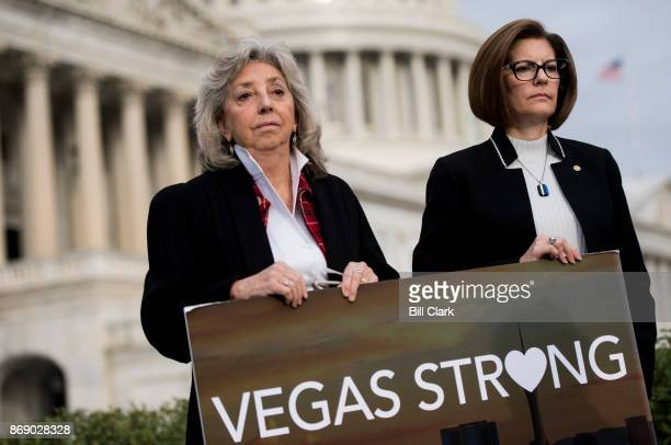 From left Rep Dina Titus DNev and Sen Catherine Cortez Masto DNev hold a Vegas Strong sign during a news conference at the Capitol on Wednesday Nov 1...