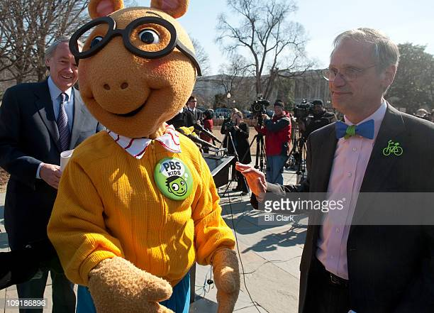 From left, Rep. Edward Markey, D-Mass., Arthur, the aardvark from PBS Kids, and Rep. Earl Blumenauer, D-Ore., end their news conference to announce...