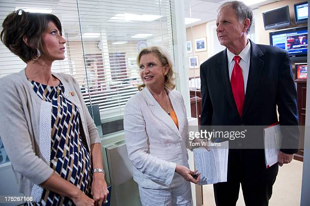 From left Rep Kristi Noem RSD Carolyn Maloney DNY and Ted Poe RTexas prepare for a news conference in the Capitol on legislation to reduce human...