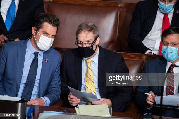 From left, Rep. Matt Gaetz, R-Fla., Rep. Jim Jordan, R-Ohio, and Rep. Mike Johnson, R-La., attend a joint session of Congress to certify the...