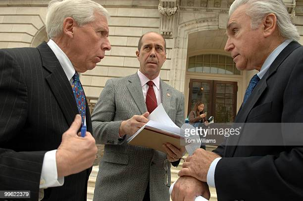 From left Rep Maurice Hinchey DNY John Hall DNY and Frank Wolf RVa talks before a news conference to announce a legislative strategy to block the...