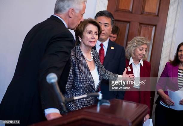From left Rep Michael Michaud DMe House Minority Leader Nancy Pelosi DCalif Reps Mark Takano DCalif Dina Titus DNev and Ann Kirkpatrick DAriz prepare...