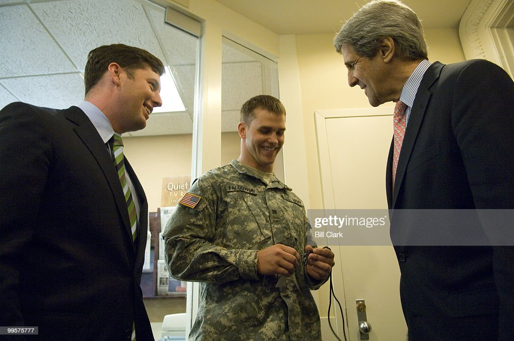 From left, Rep. Patrick Murphy, D-Pa., Mark Faldowski, an intern in Sen. John Kerry's office and a rising junior at West Point, and Sen. Kerry, D-Mass., speak with in the lobby of the Senate Radio/TV Gallery before the start of a news conference on military pay on Tuesday, May 22, 2007.