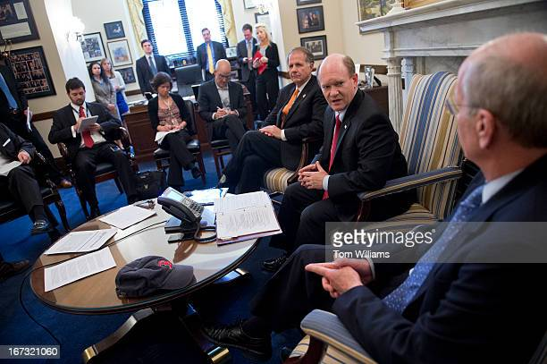 From left, Rep. Ted Poe, R-Texas, Sen. Chris Coons, D-Del., and Rep. Peter Welch, D-Vt., conduct a briefing with reporters in Coons' Russell office,...