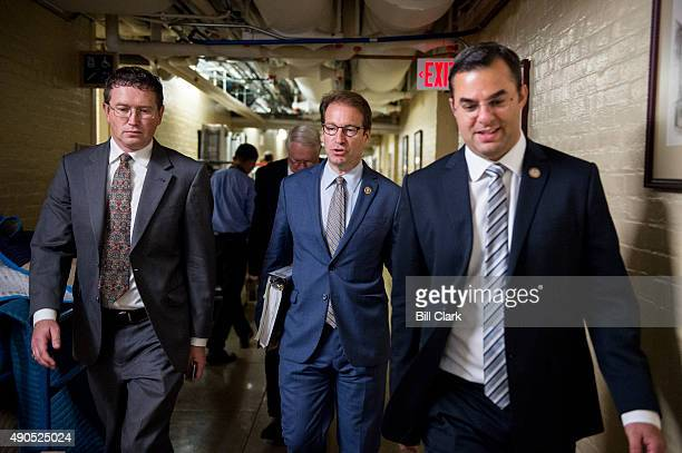 From left Rep Thomas Massie RKy Rep Pete Roskam RIll and Rep Justin Amash RMich leave the House Republican Conference meeting in the basement of the...