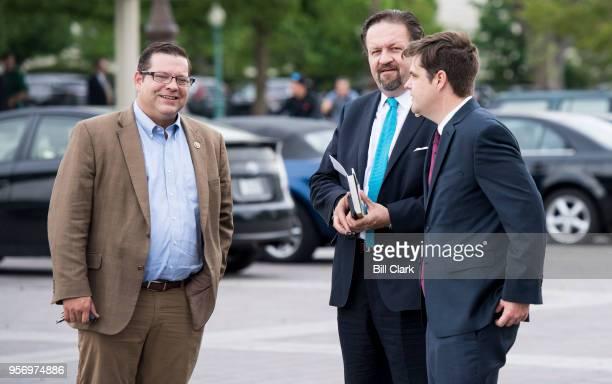 From left Rep Tom Garrett RVa former Deputy Assistant to the President Sebastian Gorka and Rep Matt Gaetz RFla talk outside of the Capitol following...