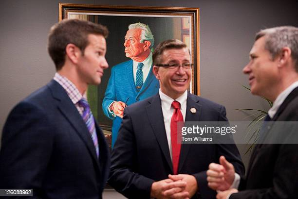 From left Reps Aaron Schock RIll Bobby Schilling RIll and Sen Mark Kirk RIll talk by the newly unveiled portrait of former Senate Minority Leader...