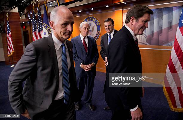 From left Reps Adam Smith DWash Ron Paul RTexas Justin Amash RMich and John Garamendi DCalif conclude a news conference in the Capitol Visitor Center...