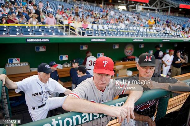 From left Reps Adam Smith DWash Tim Holden DPa and former member Bart Stupak DMich wait for the start of the 50th Annual Congressional Baseball Game...