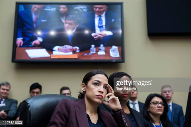 From left Reps Alexandria OcasioCortez DNY Ayanna Pressley DMass and Rashida Tlaib DMich are seen during a House Oversight and Reform Committee...