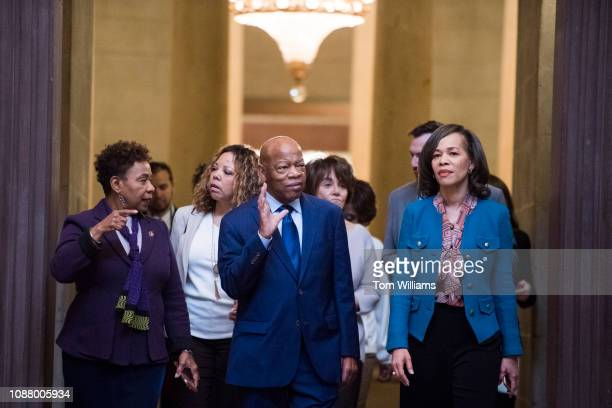 From left Reps Barbara Lee DCalif Lucy McBath DGa John Lewis DGa Anna Eshoo DCalif and Lisa Blunt Rochester DDel walk through the Capitol Rotunda...