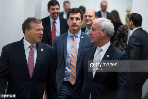 From left Reps Charlie Dent RPa Scott Taylor RVa and Bradley Byrne RAla leave a meeting of the House Republican Conference in the Capitol on October...