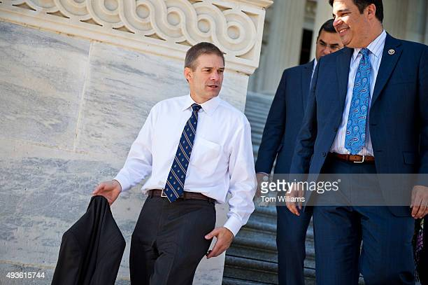 From left Reps Jim Jordan ROhio Justin Amash RMich and Raul Labrador RIdaho descend the House steps after a vote in the Capitol October 21 2015