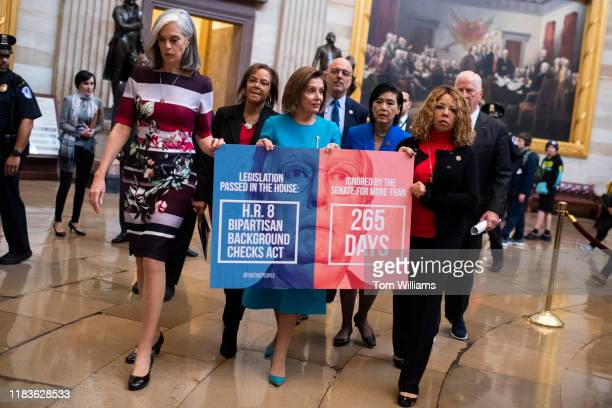 From left, Reps. Katherine Clark, D-Mass., Robin Kelly, D-Ill., Speaker Nancy Pelosi, D-Calif., Ted Deutch, D-Fla., Judy Chu, D-Calif., Lucy McBath,...
