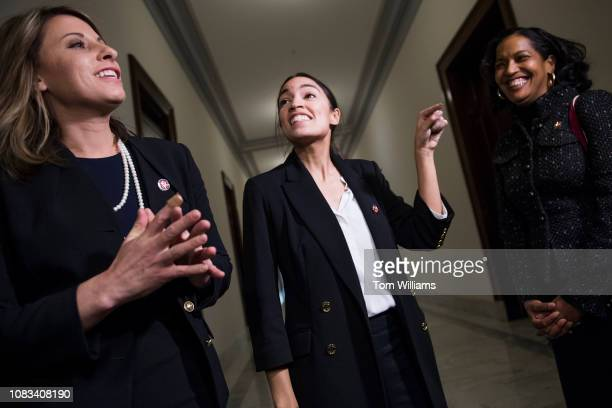 From left Reps Katie Hill DCalif Alexandria OcasioCortez DNY and Jahana Hayes DConn are seen after delivering a letter to the Russell Building office...