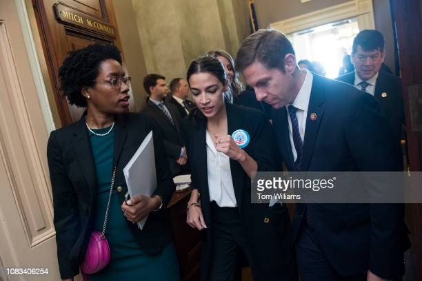 From left Reps Lauren Underwood DIll Alexandria OcasioCortez DNY and Mike Levin DCalif are seen after delivering a letter to the Capitol office of...