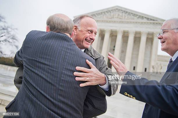 From left Reps Louie Gohmert RTexas Steve King RIowa and Joe Barton RTexas attend a rally outside of the Supreme Court during arguments in the King v...