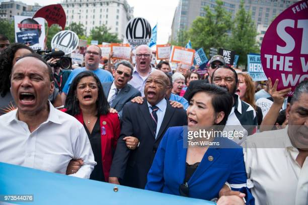 From left Reps Luis Gutierrez DIll Pramila Jayapal DWash John Lewis DGa Judy Chu DCalif Al Green DTexas Adriano Espaillat DNY and others march on...