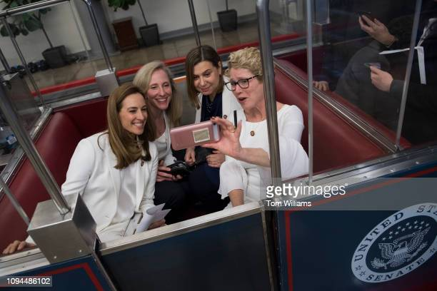 From left Reps Mikie Sherrill DNJ Abigail Spanberger DVa Elissa Slotkin DMich and Chrissy Houlahan DPa ride to Russell Building after group photo of...