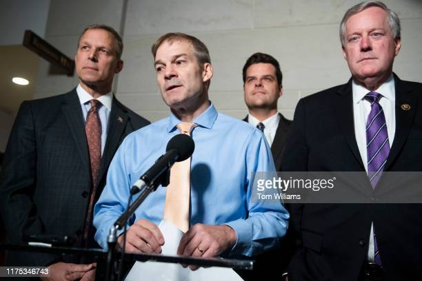 From left Reps Scott Perry RPa Jim Jordan ROhio Matt Gaetz RFla and Mark Meadows RNC speak to the media in the Capitol Visitor Center after Gordon...