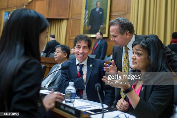 From left, Reps. Ted Lieu, D-Calif., Jamie Raskin, D-Md., David Cicilline, D-R.I., and Pramila Jayapal, D-Wash., talk with an aide during a House...