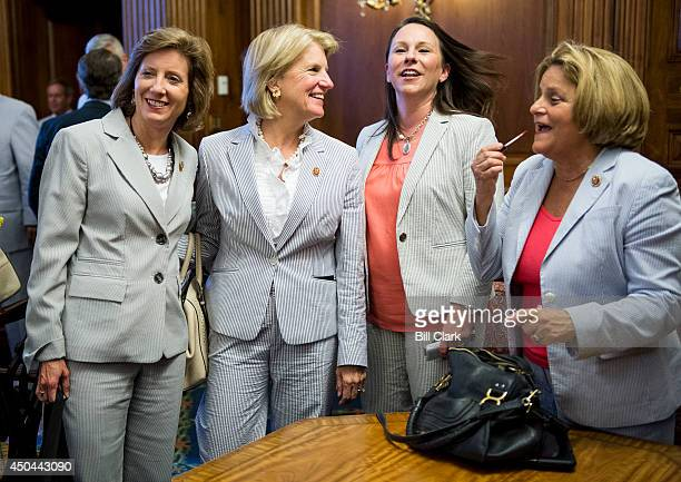 From left, Reps. Vicky Hartzler, R-Mo., Shelley Moore Capito, R-W.Va., Martha Roby, R-Ala., and Ileana Ross-Lehtinen, R-Fla., arrive for the photo-op...
