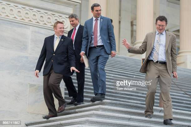 From left Reps Warren Davidson ROhio Bill Huizenga RMich Justin Amash RMich and Thomas Massie RKy leave the Capitol after the House passed a fiscal...
