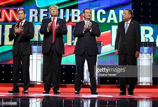 From left Republican presidential candidates Sen Marco Rubio Donald Trump Sen Ted Cruz and Ohio Gov John Kasich stand for the national anthem prior...