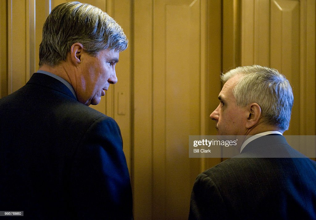 From left, Rhode Island Senators Sheldon Whitehouse and Jack Reed wait for the elevator following the Senate Democratic Policy lunch on Wednesday, Jan. 21, 2009.