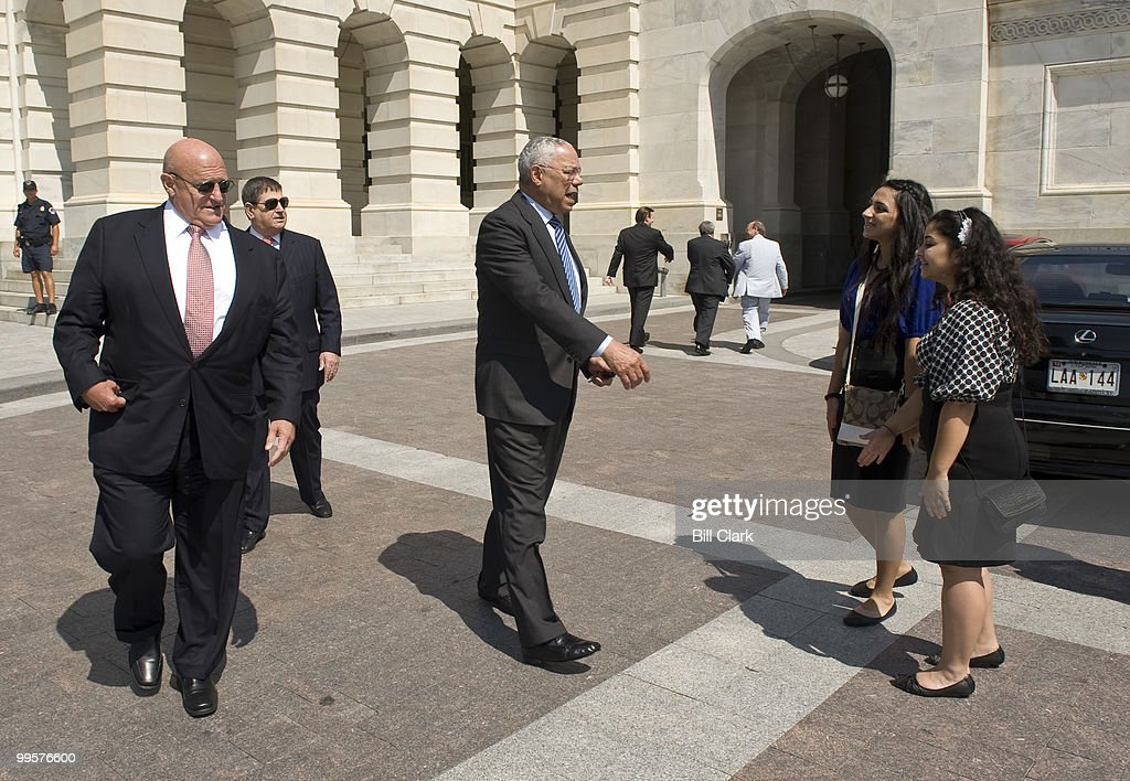 From left, Richard Armitage looks on as Former Secretary of State Gen. Colin Powell stops to shake hands and take a photo with Tatev Oganyan and Tamar Thomassian, both interns with the Armenian National Committee, as they leave the Capitol on Thursday, July 9, 2009. Powell and Armitage then hopped in a silver Corvette, with Powell driving.