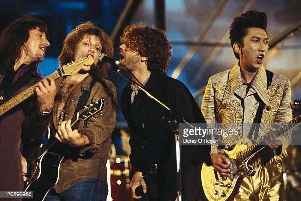 Richie Sambora and Jon Bon Jovi of Bon Jovi with Michael Hutchence of INXS performing on stage with a Japanese musician Tomoyasu Hotei at the...