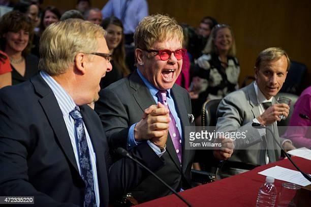From left, Rick Warren, pastor of the Saddleback Church, musician Sir Elton John, founder of the Elton John AIDS Foundation, and Mark Dybul, of the...
