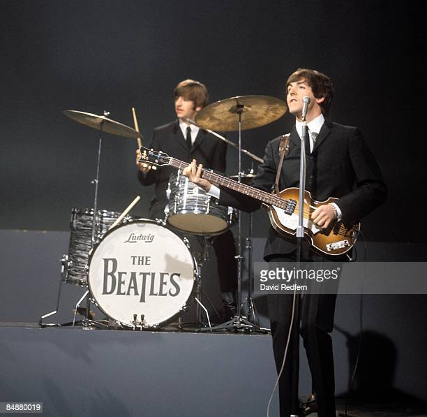 From left, Ringo Starr and Paul McCartney of English rock and pop group The Beatles perform together on stage for the American Broadcasting Company...