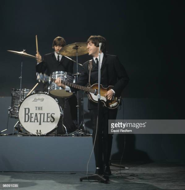 From left, Ringo Starr and Paul McCartney of English rock and pop group The Beatles perform together on stage during recording of the American...