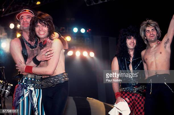 From left Rock musicians Kevin DuBrow Rudy Sarzo Frankie Banali and Carlos Cavazo all of the band Quiet Riot take a bow after a performance Milwaukee...