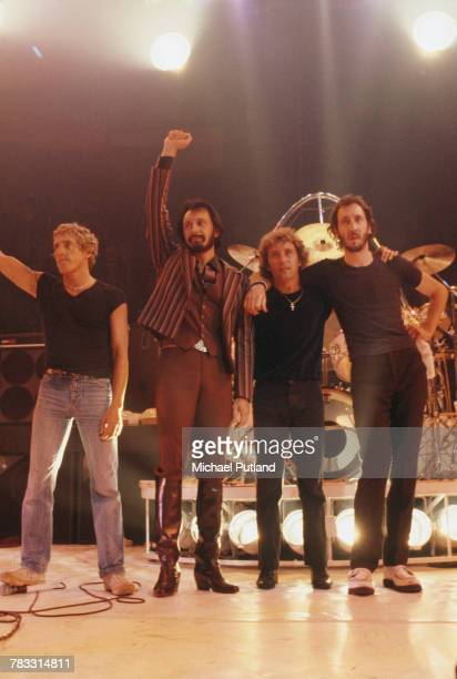 From left Roger Daltrey John Entwistle Kenney Jones and Pete Townshend of The Who wave to fans and audience members from the stage at the end of a...