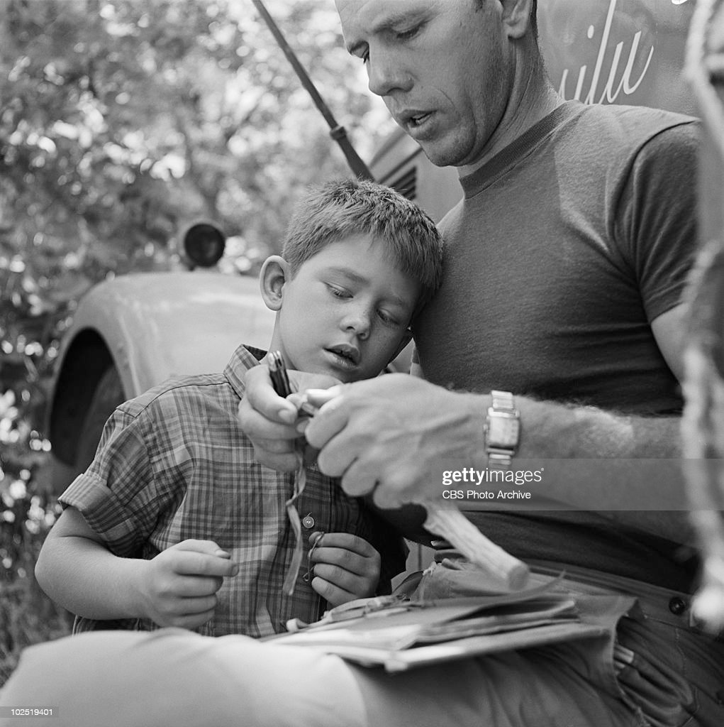 Ron Howard with his father, Rance Howard between takes of episode, 'Mr. McBeevee'. Image dated July 30, 1962. (Photo by CBS via Getty Images) Rance Howard;Ron Howard