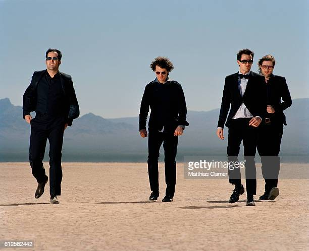 Ronnie Vannucci, Dave Keuning, Brandon Flowers and Mark Stoermer. Styling by Julie Ragolia. Grooming by Kumi Craig. On Brandon, light-blue...