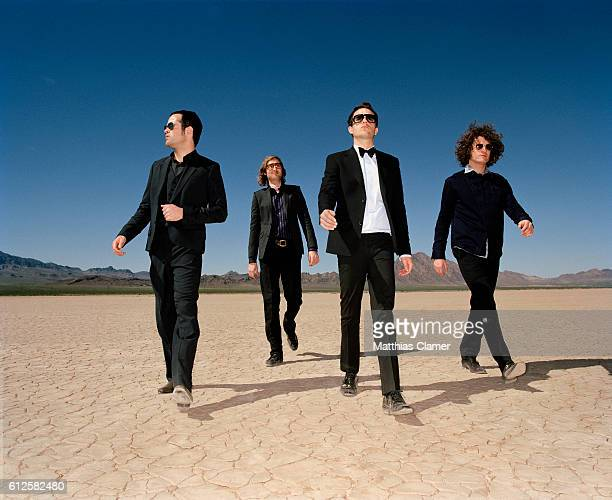 Ronnie Vannucci, Mark Stoermer, Brandon Flowers and Dave Keuning. Styling by Julie Ragolia. Grooming by Kumi Craig. On Brandon, light-blue...