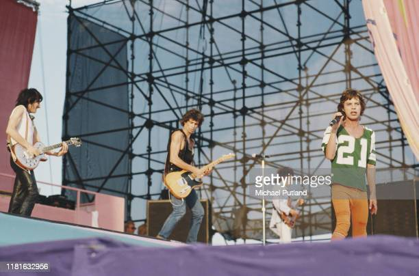 From left Ronnie Wood Keith Richards Bill Wyman and Mick Jagger of English rock group the Rolling Stones perform live on stage at the John F Kennedy...