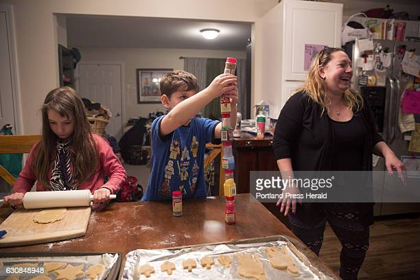 From left Roxy Rovin Everett Rovin and their Mom Amy Starr bake and decorate Hanukkah cookies at their home in Gorham The family is also helping...