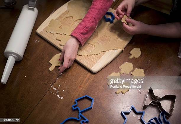 From left Roxy Rovin Everett Rovin and their Mom Amy Starr bake and decorate Hanukkah cookies at their home in Gorham The family is helping Starr's...