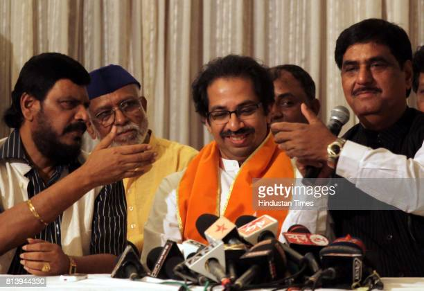 From left RPI leader Ramdas Athavale Shiv Sena leader Uddhav Thackeray and BJP leader Gopinath Munde during a press conference at Rangsharda in...