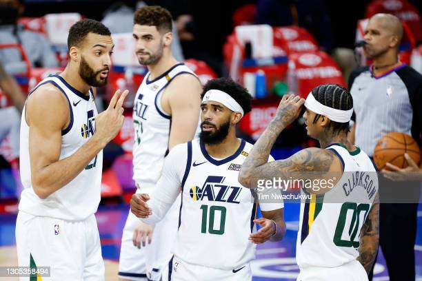 From left, Rudy Gobert, Mike Conley and Jordan Clarkson of the Utah Jazz conference during the first quarter against the Philadelphia 76ers at Wells...