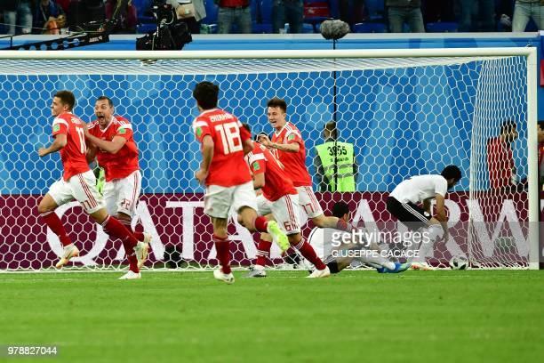 Russia's midfielder Roman Zobnin Russia's forward Artem Dzyuba Russia's midfielder Denis Cheryshev Russia's midfielder Yury Zhirkov and Russia's...