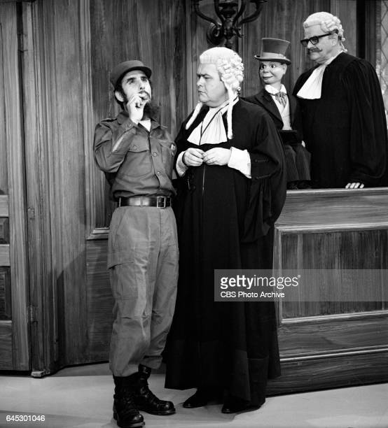 From left Saadoun Bayati plays Fidel Catro Jonathan Winters as a prosecutor and Ventriloquist Edgar Bergen and his puppet Charlie McCarthy perform...