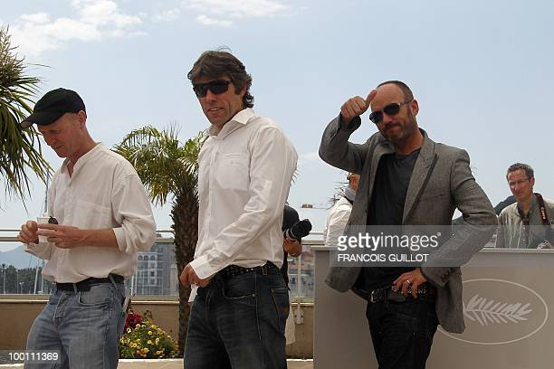 screenwriter Paul Laverty British actors John Bishop and Mark Womack pose during the photocall 'Route Irish' presented in competition at the 63rd...