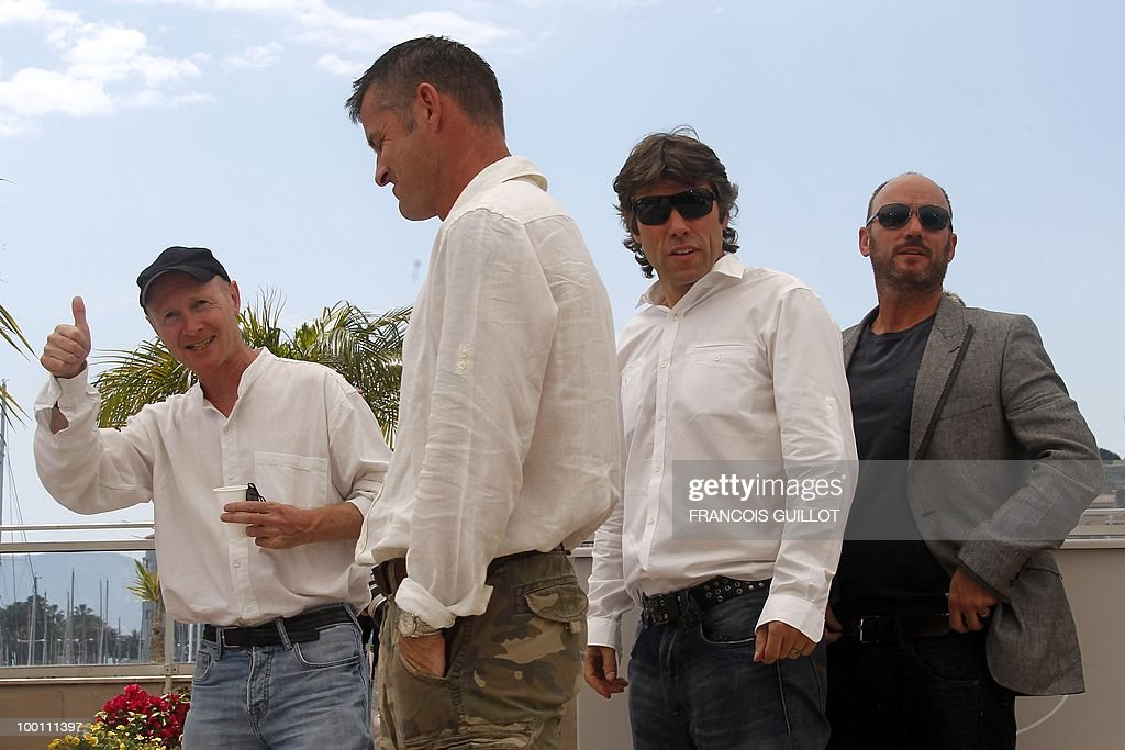 screenwriter Paul Laverty, British actors Trevor Williams, John Bishop and Mark Womack pose during the photocall 'Route Irish' presented in competition at the 63rd Cannes Film Festival on May 21, 2010 in Cannes.