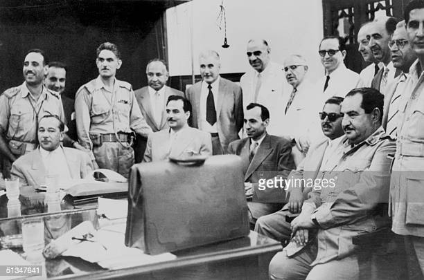 From left seated Iraqi politician Abdul Salam Arif and Iraqi Prime minister brigadier AbdulKarim Qassem are surrounded by the members of Iraqi...